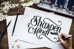 An artist creating hand lettering artwork stock image