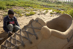 A artist creating a sand sculpture, Durban Royalty Free Stock Photography