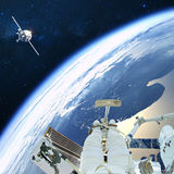Artist creative edit composite depicting activities on ISS. Astronauts floats on space. Artist creative edit composite depicting activities on International Stock Images