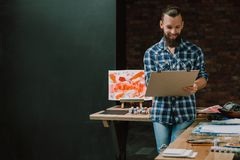 Artist delight painting panel ideas skills hobby. Artist delight. Smiling bearded guy with board panel. Painting gaining inspiration generating ideas mastering stock images