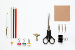 Artist designer workspace flat lay. Designer or artist desktop workspace flat lay with tools, succulent plant and notebook on white background. Top view with Stock Photo