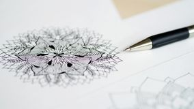 Artist desk top view pen, pencil mandala flower floral hand drawing Royalty Free Stock Images
