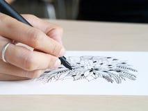 Artist desk top view pen, pencil mandala flower floral hand drawing Stock Photography