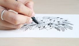 Artist desk top view pen, pencil mandala flower floral hand drawing Royalty Free Stock Image