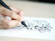 Artist desk top view pen, pencil mandala flower floral hand drawing Royalty Free Stock Photo