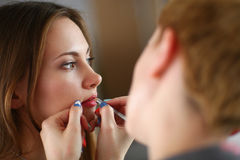 Artist doing professional make up of woman Stock Images