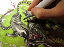 Artist drawing 2. Artist´s hand making a drawing Royalty Free Stock Image