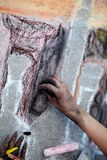 Artist drawing with chalk. Hand of artist drawing picture on sidewalk with chalk Royalty Free Stock Photos