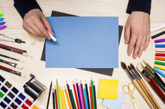 Artist drawing with chalkstick Royalty Free Stock Photos