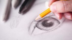 Artist drawing eye. Lash with a wooden graphite pencil. 4k stock video footage