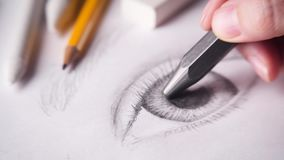Artist drawing eye. With a big graphite pencil. 4k stock footage