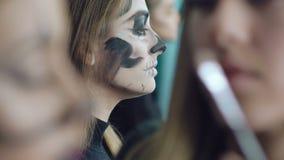 Artist drawing girl skull- makeup in art studio. In full HD stock video footage