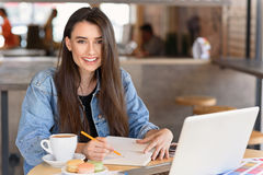 Artist drawing in her diary in a public place Royalty Free Stock Photo