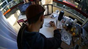 Artist drawing a Lotus stock photos