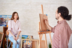Artist Drawing Portrait of Beautiful Model in Art-Studio Stock Photos
