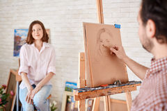 Artist Drawing Portrait of Model in Workshop Royalty Free Stock Photo