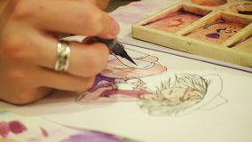 Artist drawing a sketch. With the watercolors paints stock footage