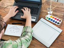 Artist drawing Sketch on Graphic Tablet Top View. Young Man designer occupation drawing sketch using paper and graphic tablet top view royalty free stock image