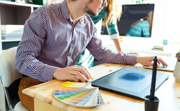 Artist drawing something on graphic tablet at the home office Royalty Free Stock Image