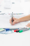 Artist drawing something on paper with pen at office Royalty Free Stock Photography