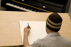 Artist at Drawing Table Stock Photography
