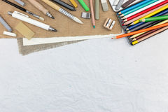 Artist drawing tools on recycled paper background Royalty Free Stock Images