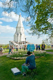 Artist draws christian temple in Kolomenskoye park. Moscow. Royalty Free Stock Photos