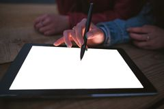 Artist draws on an empty graphic tablet, closeup Stock Photography