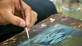 Artist draws a little picture close up. Cambodia stock footage