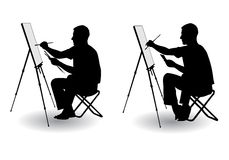 Artist draws. The artist sitting at his easel and paints paints on canvas Royalty Free Stock Images