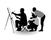 Artist draws. The artist sitting at his easel and paints paints on the street Royalty Free Stock Photography