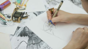 The artist draws a sketches with pencil for tattoo stock video