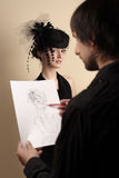 Artist draws the woman Stock Photos