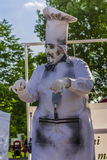 Artist dressed as chef. Artist dressed as a cooking chef during a street art performance at International Festival of Living Statues on May 30, 2015 in Bucharest Stock Photos