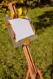 Artist easel in a city park. Isolated empty canvas and easel in a city autumn park Stock Photography