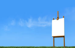 Artist easel on grass Stock Photos