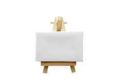 Artist Easel. Miniature artist easel, isolated against a white background royalty free stock photos