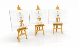 Artist easels with paintings Stock Photo