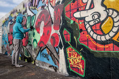 Artist at East side of Berlin Wall, Berliner Mauer, Berlin Stock Photo