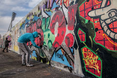 Artist at East side of Berlin Wall, Berliner Mauer, Berlin Stock Images