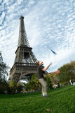 Artist at eiffel tower. An acrobat in front of the eiffel tower royalty free stock photography