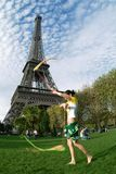 Artist at eiffel tower. An acrobat in front of the eiffel tower Royalty Free Stock Images