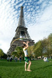 Artist at eiffel tower. An acrobat in front of the eiffel tower stock image