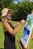 artist female fifties her painting Στοκ εικόνα με δικαίωμα ελεύθερης χρήσης