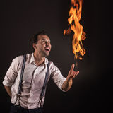Artist with fire in his hands. Royalty Free Stock Photography