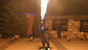 Artist with a flamethrower in his hand during a performance. Fireshow. Artist with a flamethrower in his hand during a performance. Fireshow stock video
