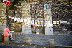 Artist in front of her self-created street gallery, Montmartre, Paris Stock Photos