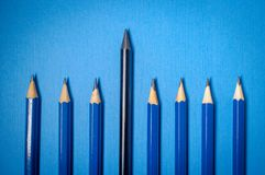 Artist Graphite Pencils. Rows of artist graphite pencils on blue background royalty free stock photography