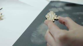 An artist grinds wooden craft on sandpaper.  stock footage