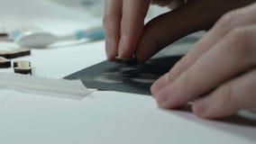 An artist grinds wooden craft on sandpaper.  stock video footage